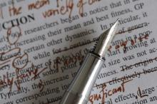 Photo of a page being edited by pen.