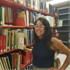 Photo of a librarian with books
